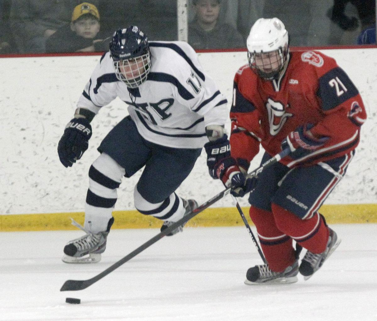 Central Catholic's Billy Stahley, right, takes the puck to the net against St. Johns Prep. The senior has overcome illness to emerge as one of the top scorers for the Raiders.