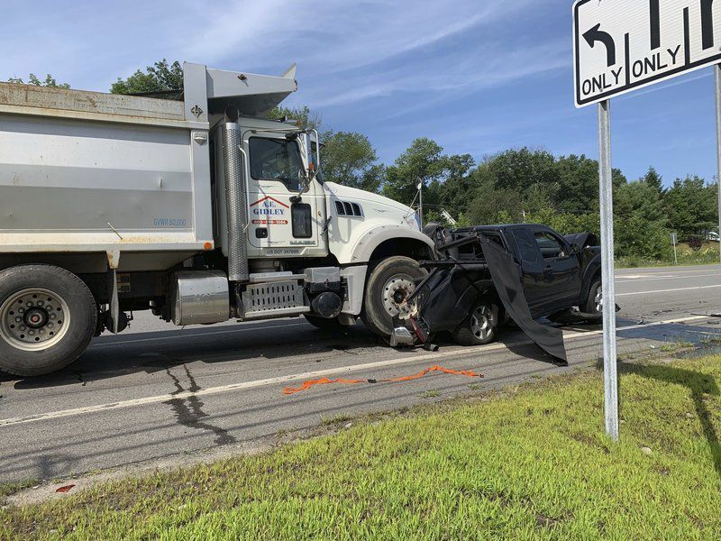 21 people sent to hospital after school bus, dump truck and pickup collide