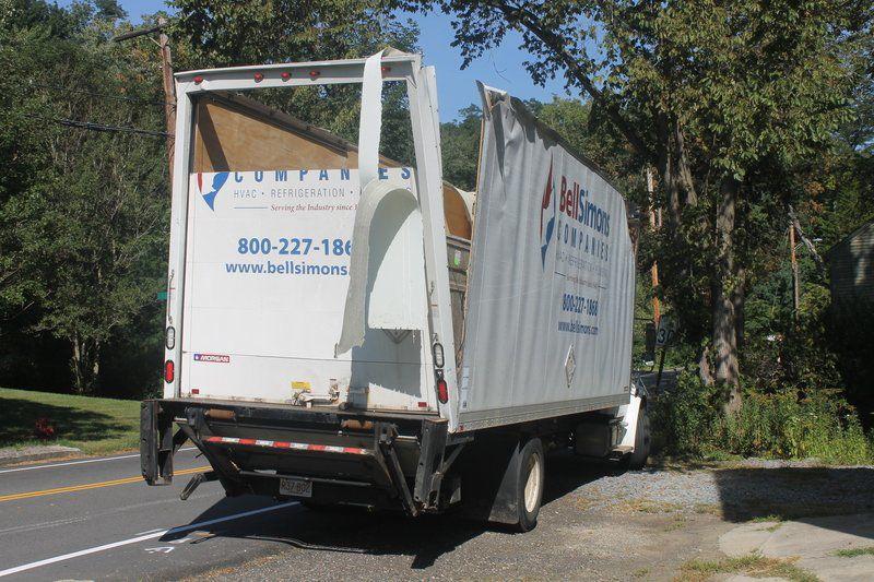 Truck loses roof on Rocks Village Bridge