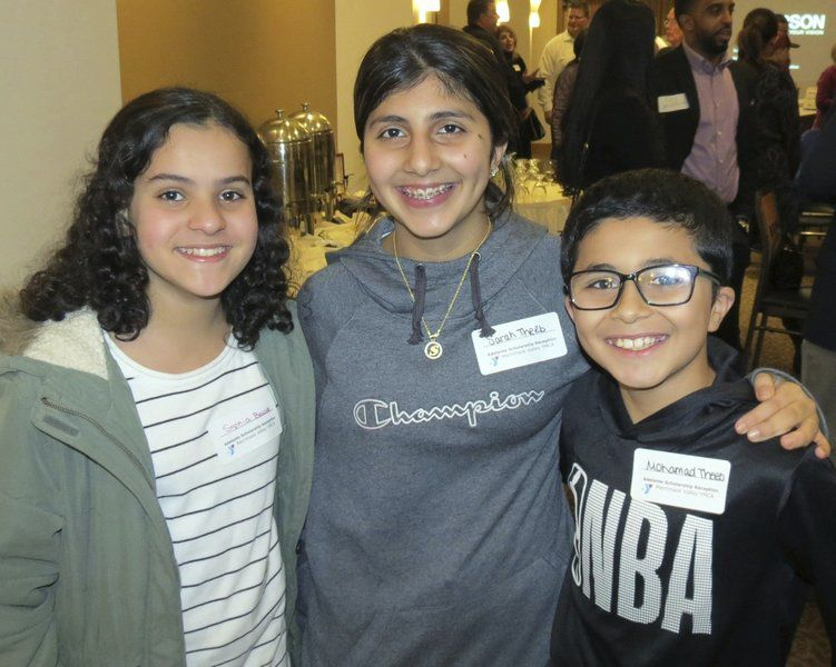 STEPPING OUT: Merrimack Valley YMCA's Adelante Scholarship Raffle and Reception
