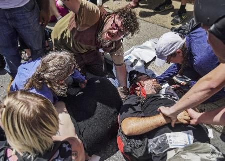 Driver who plowed into Charlottesville crowd reported to have held Nazi views