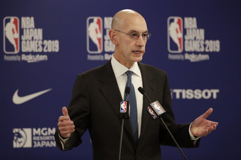 Wary NBA, players sign off on terms for restart