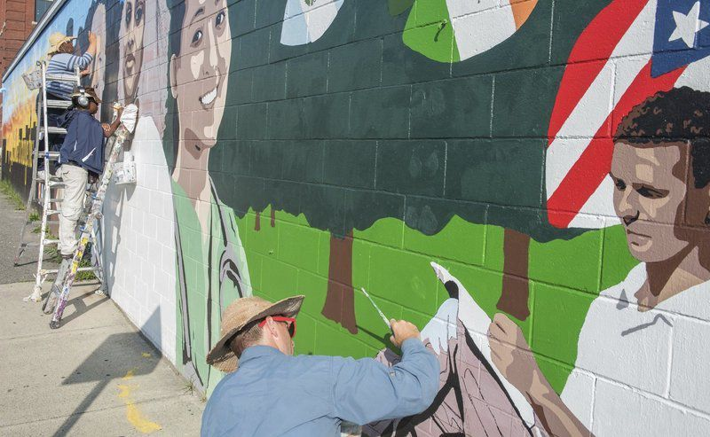It Gives Color To The City Lawrence Mural Represents Education