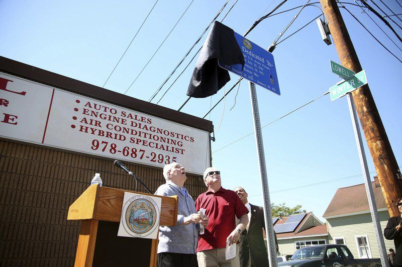 Sign replaced to pay tribute to fallen Lawrence soldier