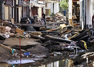 German leader tours 'surreal' flood scene