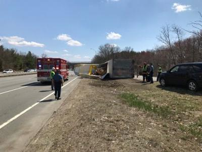 Tractor-trailer rollover spills watermelon load, fuel along I-93 in