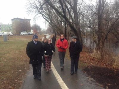 EEA Secretary Bartlett and Lawrence Mayor Dan Rivera tour the Spicket River Greenway.