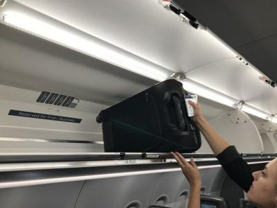 Airlines add bigger luggage bins but don't want you to pack more