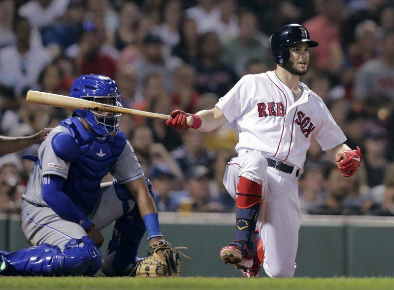 Porcello, Travis help Red Sox halt 8-game skid