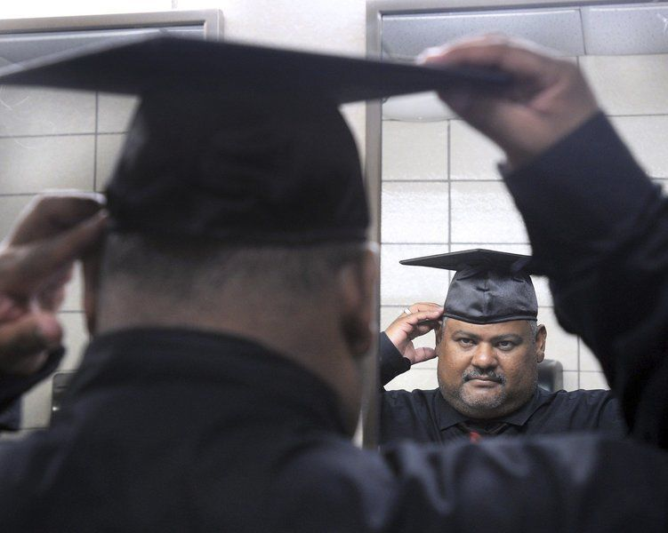 Father and son graduate - both with high honors