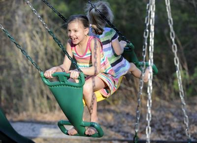 Tim Jean Staff Photo Cancer Survivor Madison Becht 8 Plays On The Swings With Her Sister Elizabeth 5 At Their Home In Windham