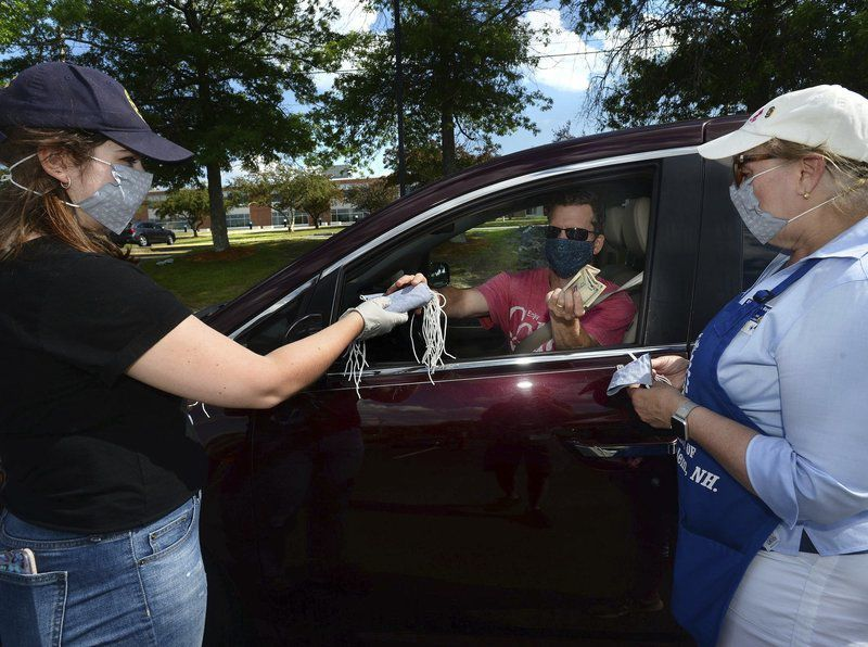 Rotary passes out masks in Salem