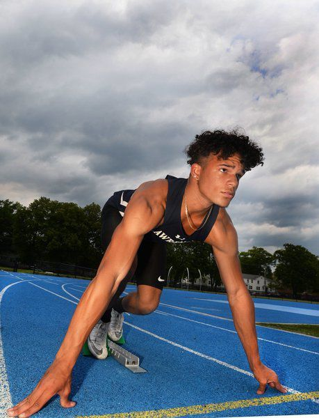 Lawrence's German smashes area 100 dash record in first year of track