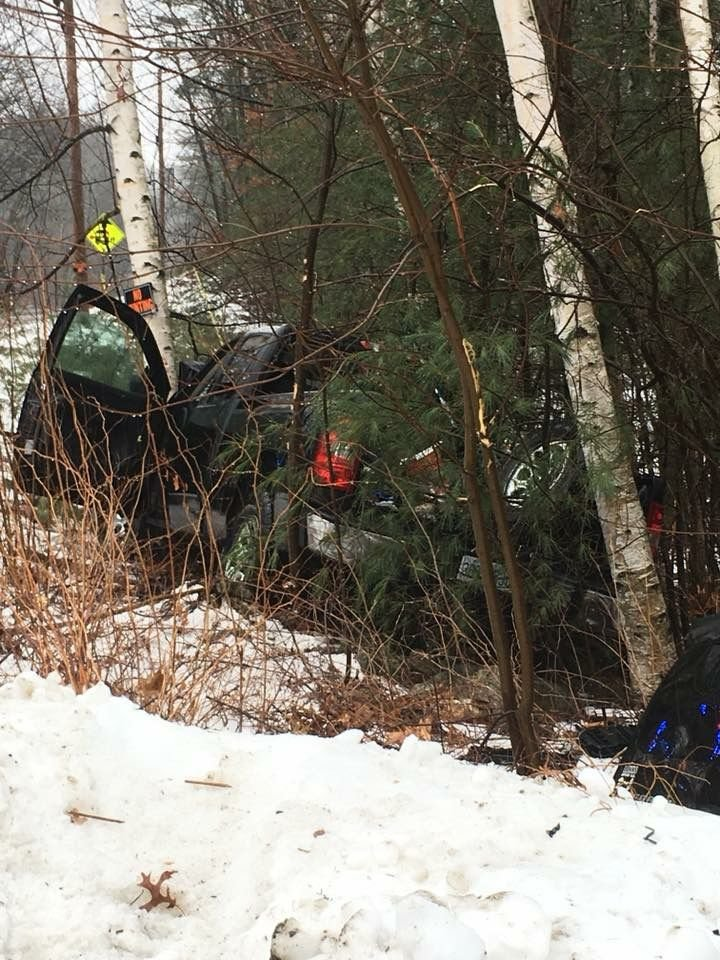 Pickup truck in woods after crash