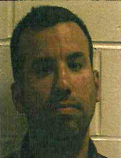 Man arrestedfor photographinggirl in shower