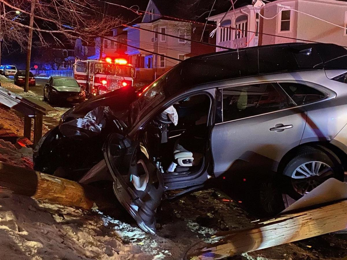 Car takes out pole, lands on parked car in Tower Hill crash