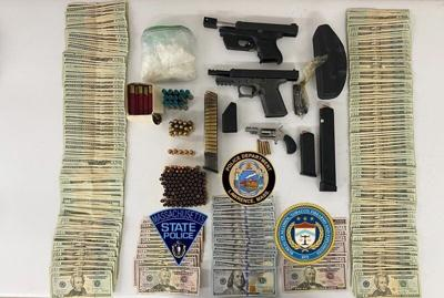 Police: Child found at auto shop when guns, drugs seized