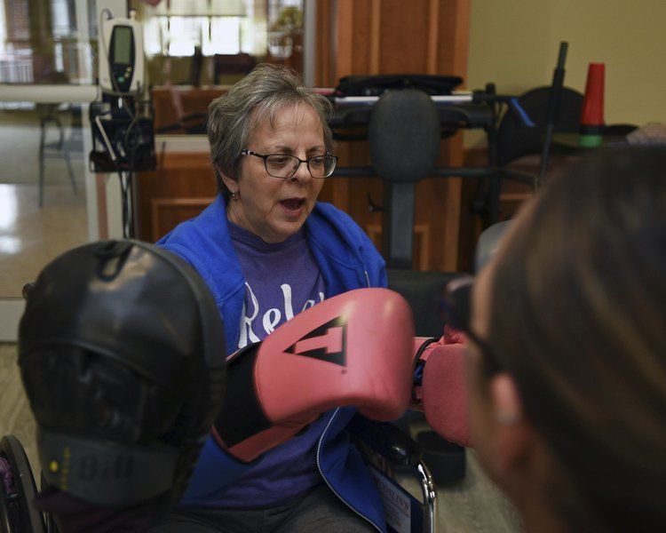 Woman throws a punch at cancer