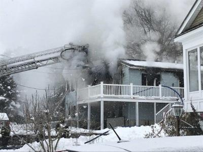 Woman pulled from Salem house fire dies at hospital