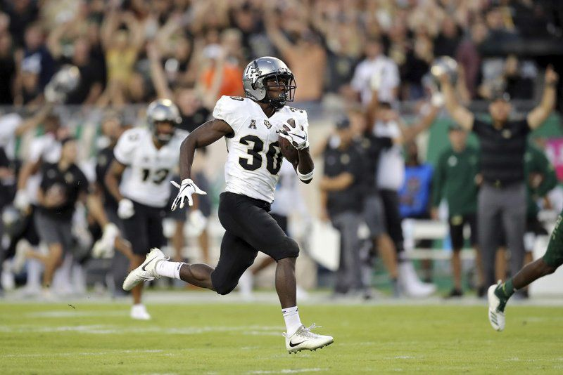 College Football Roundup Ucf Remains Unbeaten But Loses Qb Milton