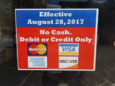 City parking lots, garages will go cashless. Credit or debit cards ...