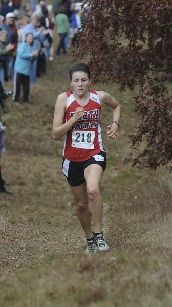 Shouldn't Mass. be at New England in cross country?