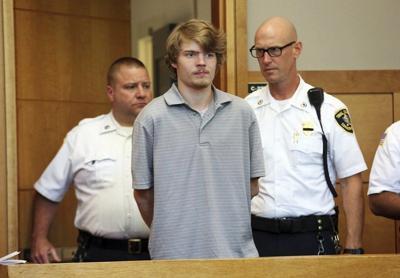 Murder suspect remains in jail