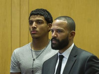 Accused high school dealer remains in jail