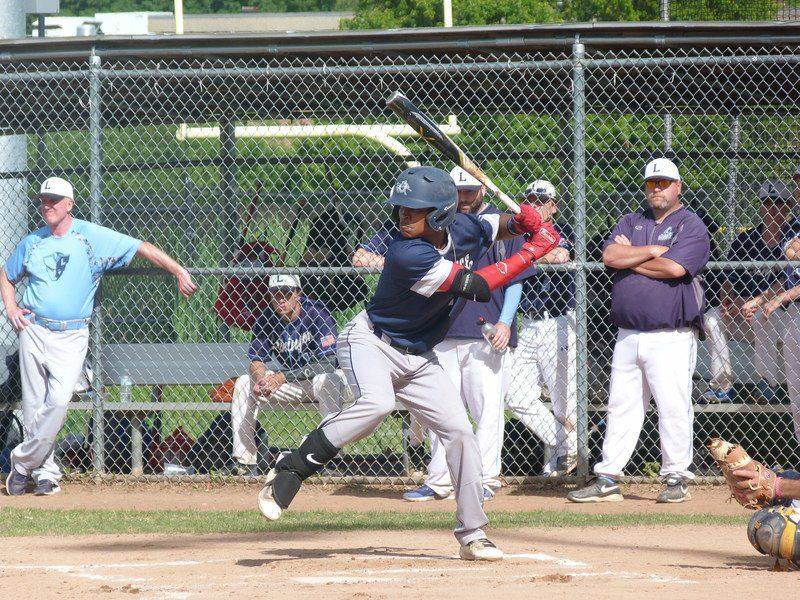 Medina fights injury, tosses 2-hit gem to send Lawrence to semis