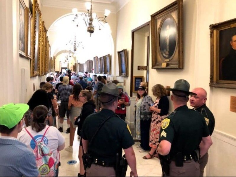 Hundreds protest state budget, police called