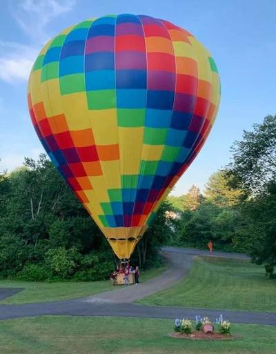 Surprise landing: Hot air balloons touches down in yard