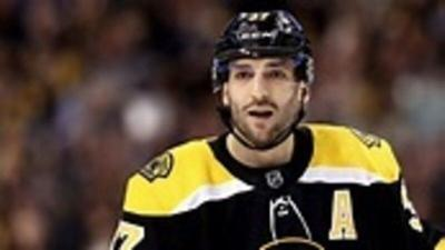 Bergeron milestone gives a lift to Bruins