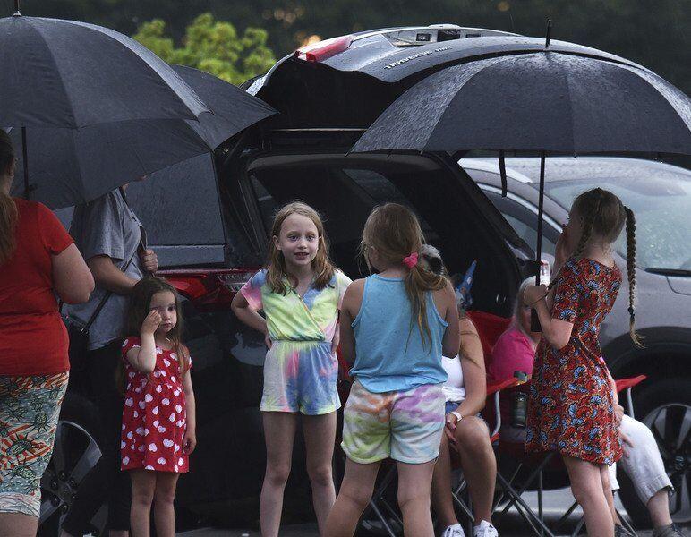 Revelers don't let rain dampen July 4th fete