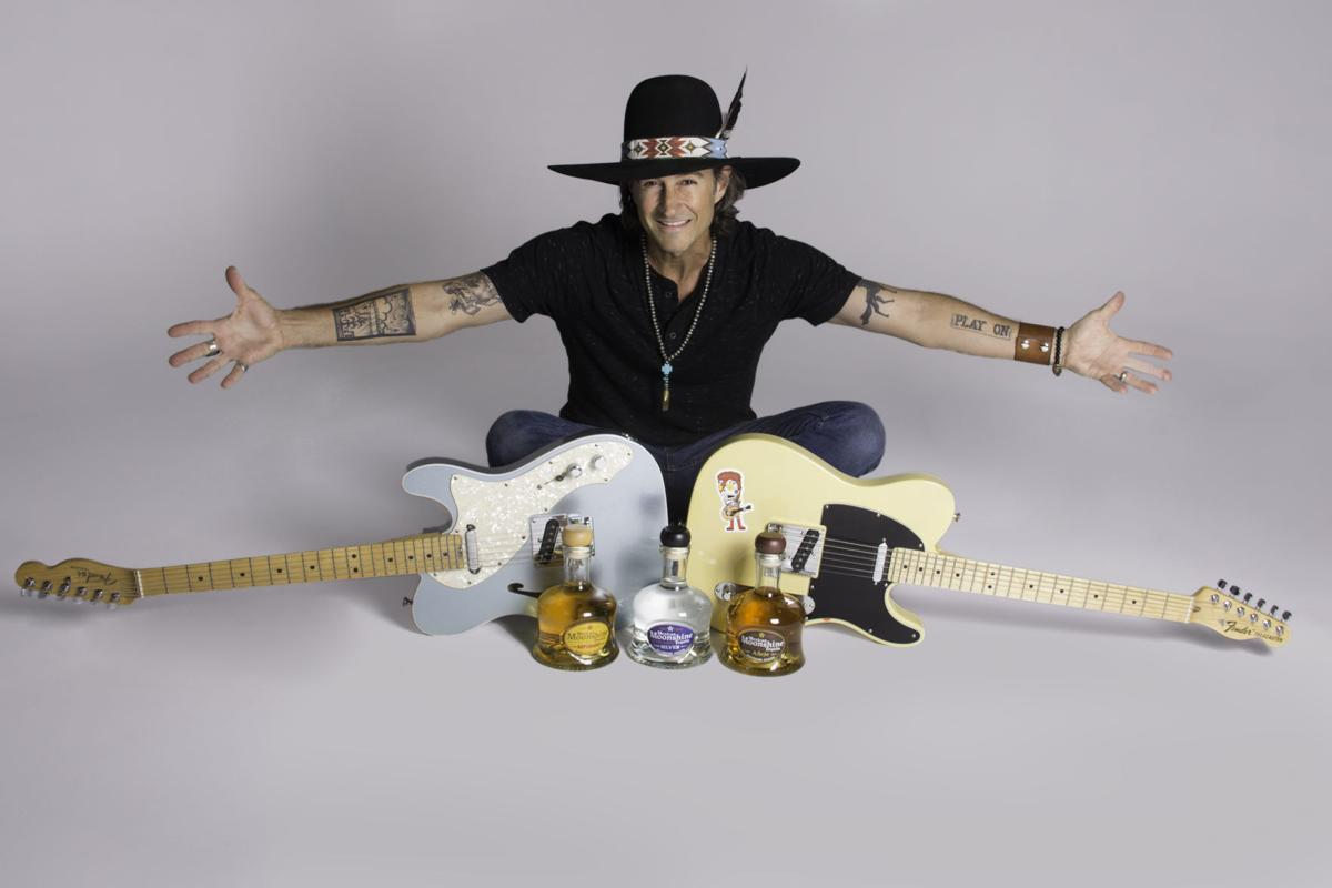 Roger Clyne says he is careful not to blur the lines between his art and his company, Mexican Moonshine Tequila.