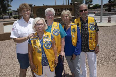 Zara King, Judy Ahlberg, Kit McCormick, Barb Wright and Ken Ahlberg flag America's birthday