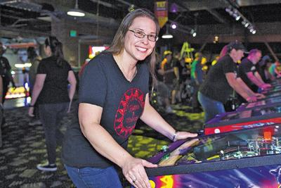 Tracy Lindbergh of Chandler plays pinball at Tilt Studio in Arizona Mills mall in Tempe
