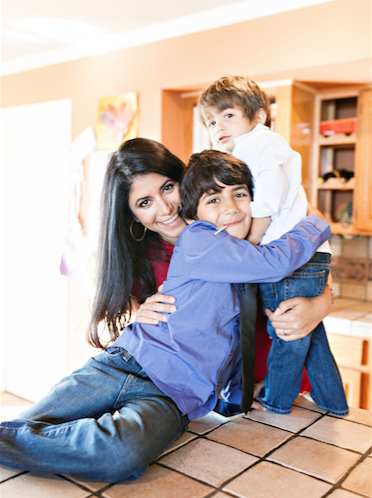 Lilach Mazor Power bonds with her sons Shai, left, and Ben during a break from the demands of her business.