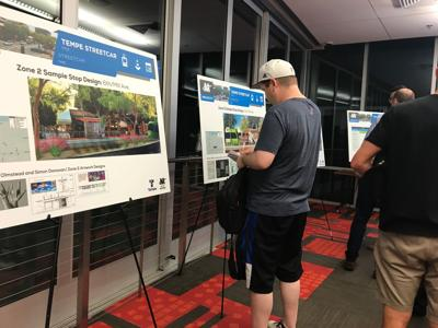Tempe residents take a look at proposals for the streetcar project. About 30 people attended a meeting at the Tempe Transportation Center.