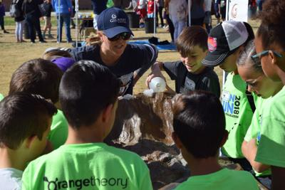 Gilbert Public Schools learn about erosion at the Gilbert Water Festival on the grounds of the Gilbert Civic Center.