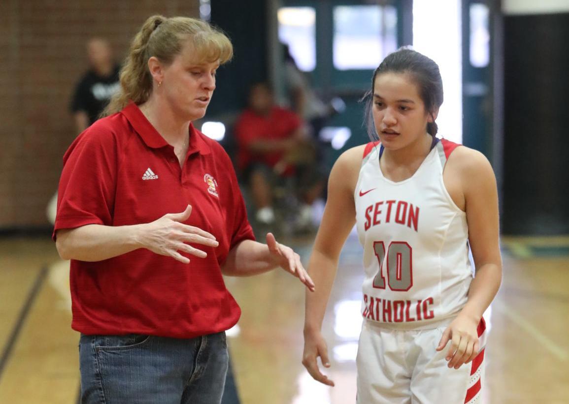 Seton Catholic girls basketball coach Karen Self gives some pointers to sophomore Megan Giacobbi.