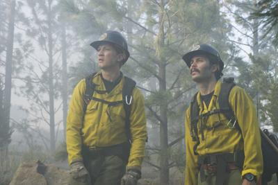 "Brendan McDonough (Miles Teller) and Chris MacKenzie (Taylor Kitsch) plan to do the backburn at the Chiricahua Mountain fireline in Columbia Pictures' ""Only the Brave,"" the true story of the Granite Mountain Hotshots."