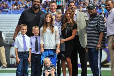 Todd Heap (back, second from left) was inducted into the Baltimore Ravens Ring of Honor in September 2014. With him is his family, and in the stroller is his daughter Holly, who was killed April 14.