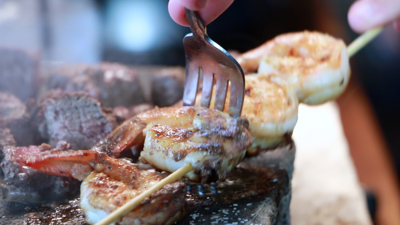 Patrons can dine on shrimp and sirloin cooked on hot stones at Steak and Stone of Gibert, owned by David Reay of Queen Creek, cofounder of the successful Classy Closets company.