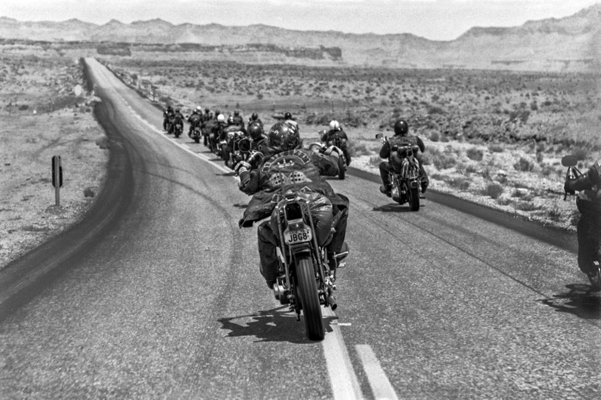 Neil Miller's photographs capture the Dirty Dozen motorcycle club against the rugged Arizona desert background.