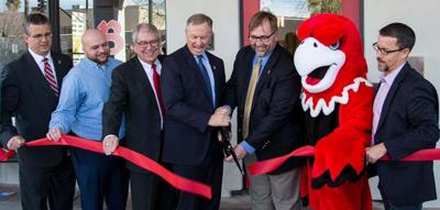 Mesa Mayor John Giles (center), along with other officials from Benedict University, cut the ribbon on the school's new dormitory