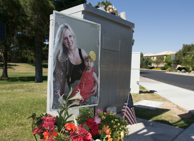 A makeshift memorial at Ponderosa and Ray roads in Chandler featured a photo of Pamela Hesselbacher and her daughter Audrey. The little girl survived the accident, but Pamela was killed.