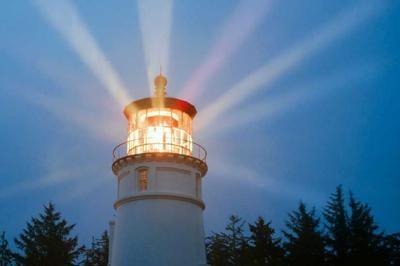 Lighthouse Beams Illumination Into Rain Storm Maritime Nautical Beacon