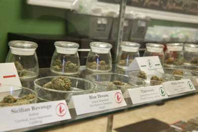 Prescription marijuana samples sit on a shelf in Giving Tree show in Mesa