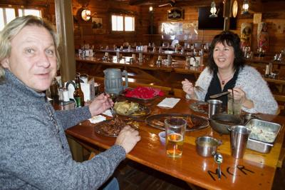 Christopher Truitt and Suzanne Case enjoy the family-style dining at Mining Camp