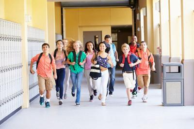 Group Of Elementary School Students Running Along Corridor Chandler Unified may build new